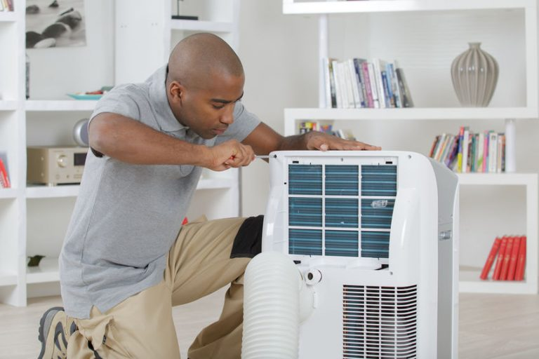 guy installing a air conditioner